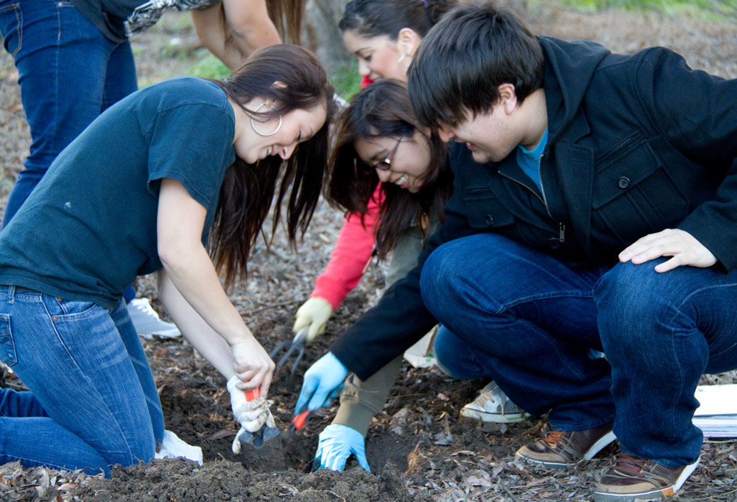 Students on an archeological dig at the LMC lake