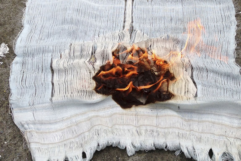 Meredith Brion, video still of textile with fire